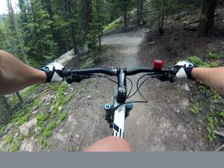 Barreling into a berm on the V3 trail in Breckenridge. (Props for having bike bell!)