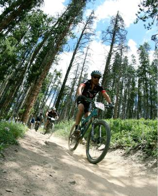 Riders charge down the final mile of singletrack on Barney Ford above Carter Park in Breckenridge during the Firecracker 50 race. The trail is popular with downhill riders for whip-fast straightaways and flowy turns, but the multi-use, multi-directional nature can make it dangerous.