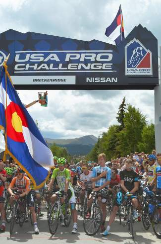 Riders salute at the starting line before beginning Stage 3 of the 2013 USA Pro Challenge in Breckenridge. This year, Summit County plays host to four stages — the most in race history.