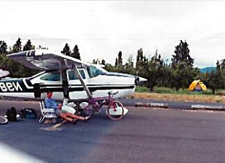 Nick Hawkins takes a break by a Cessna 187 on the runway at Hood River, Oregon, in 2000. Hawkins and his stepfather, Wiliam Moody, traveled the country mountain biking from the back of a Cessna 187 in the late '90s as Moody was earning his pilots license.