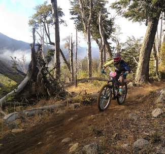 Summit local Leigh Bowe rides the misty trails of Argentina during a race series in 2015.