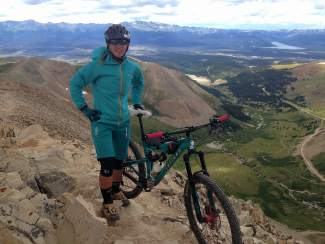 Summit local Leigh Bowe with her bike at the summit of Mount Sherman (14,035 feet), a 14er in the Leadville area. Bowe decided to climb the 14er for the first time last summer as a respite from several devestating incidents in the spring.
