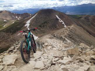 Leigh Bowe's Santa Cruz bike on top of Mount Sherman (14,035 feet) last summer. Bowe took her first ride up the Leadville-area 14er on a whim last year, when she was cheered by hikers and other trekkers.