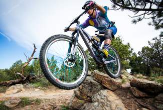 Summit County local Leigh Bowe charges boulders during an enduro race in 2015.
