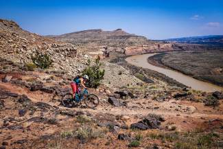 Summit local Sarah Rawley weaves through the trails outside of Grand Junction. The Oregon native has travelled the state and nation for the women's-only VIDA mountain bike series, a series she founded to bring more ladies into the mountain bike community.