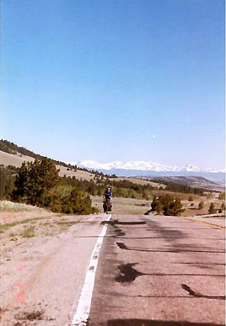 Monte Lowrance rides a deserted stretch of Utah with the Rocky Mountain in the background during a cross-country solo bike trip in 1997. The trip took him about 10 months total and touched all 48 continental states.