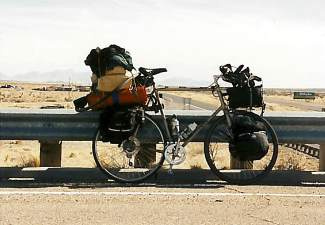 A fully loaded Trek 420 touring model early during Monte Lowrance's quest to bike solo across the nation and touch all 48 continental states, plus Washington, D.C. Lowrance struggled through the first month with the load, which weighed upwards of 50 pounds, before meeting a couple on the west coast that loaned him a bob trailer for the final nine months.