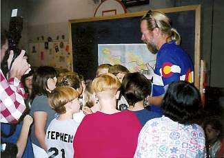 Monte Lowrance (blue jersey) talks with elementary school students shortly before finishing his cross-country solo bike tour in 1997. The longtime Summit County native hit all 48 continental states and visited about a dozen friends during the 10-month journey covering 11,800 miles.