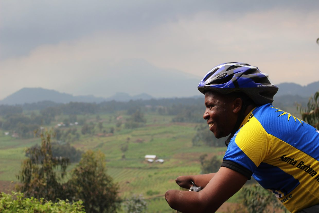 Scenes from the Rwanda bike journey local Christie Abel made with Frederick Ndabaramiye (pictured), a young man she met in 2002 when teaching at a school for survivors of the country's genocidal civicl war. Abel and Ndabaramiye met again in 2013 when she returned to Rwanda for the bike ride.