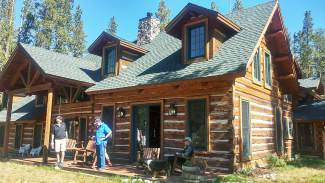 Guest on the Bill's Ranch tour enjoy the Ophir Lodge patio. The lodge was moved from Main Street Frisco to Bill's Ranch in 1931.