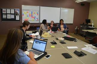 An entrepreneurial team in Breckenrdedge gets busy last month during their 54-hour window to develop a startup company. Alex Huppenthal hopes to use events like this to transform rural America into an entrepreneurial heartland.