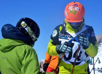 U.S. Freeskiing team member Jaxin Hoerter (facing) gets a pep talk from a coach before dropping in for his second run at the 2016 GoPro Big Mountain Challenge on Peak 6 at Breckenridge March 19. The 14-year-old Breckenridge skier was one of more than 50 local athletes at the youth-only competition.