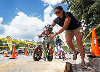 Mom helps her little one through the Strider bike course just off of Main Street Breckenridge during Breck Bike Week on June 25.