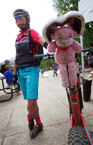 Pig in the mud: A mountain biker and her riding partner during Breck Bike Week on June 23.