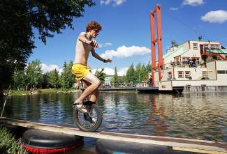 A unicyclist truly tests his balance on the elevated 2x4s of the pond crossing competition in downtown Breckenridge for Breck Bike Week on June 25.