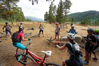 An instructor leads an all-female group through mountain bike skills at the new Wellington bike park for Breck Bike Week on June 23.