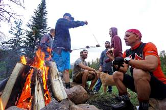 A group of mountain bikers takes a pause for s'mores at dusk during a night ride to Baker's Tank on Boreas Pass for Breck Bike Week on June 25.