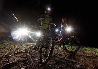Mountain bikers get ready for a headlamp descent down Boreas Pass on a night ride to Baker's Tank for Breck Bike Week on June 25.