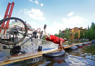 A competitor goes from up to down in a split second during the pond crossing competition in downtown Breckenidge for Breck Bike Week on June 25.