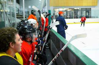 Breckenridge Bucks player Brendan Russ (far left) watches with teammates from the bench during practice on Sept. 30. The Bucks face off against the Aspen Leafs for the first home stand of the season this weekend in Breckenridge.