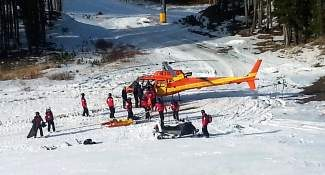 "Breckenridge Ski Resort ski patrol personnel transport a 21-year-old Colorado man onto a Flight for Life helicopter following a snowboarding incident Saturday on 4 O'Clock, a ""more difficult"" trail."