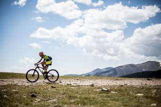 A lone competitor rides high on the Continental Divide at the 2014 Breck Epic stage race. The race crosses the Divide several times over six days of competition and returns this summer from Aug. 14-19.