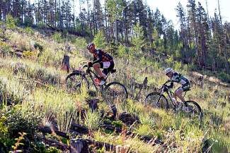 Overall leaders Todd Wells(leader) and Alex Grant charging up hill during one of the stages of the six-stage Breck Epic this week.