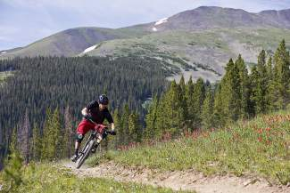 A mountain biker weaves along the singletrack at Breckenridge Resort. For Breck Bike Week on June 25, the resort is hosting the first-annual BRK MTN Enduro for adult and junior riders, with two timed sections and occasional uphills.