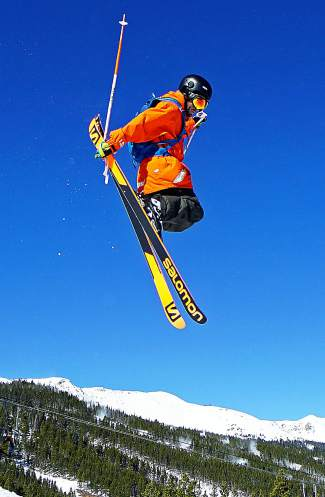 A skier jumps in the freestyle park during Breckenridge Ski Resort's season opening day Friday.