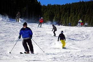 Skiers and snowboards come down the mountain after lifts began running for the 2015-16 season at Breckenridge Ski Resort on Friday, Nov. 13. A recent study says the ski industry has an economic impact on Colorado of $4.8 billion.