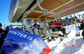 From left to right, Breckenridge Ski Resort COO John Buhler, veteran Zach Barrett, an unnamed Breckenridge executive, veteran Keith Deutsch's daughter, Ski and Snowboard School training supervisor Nina Michel, and veteran Keith Deutsch took the resort's first chair of the 2015-16 season up the mountain on Friday, Nov. 13.