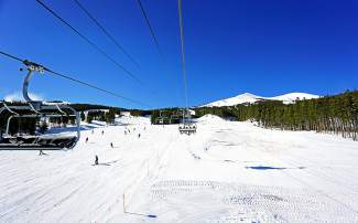 Skiers and snowboarders were greeted to bluebird skies for Breckenridge Ski Resort's opening day of the 2015-16 season on Friday, Nov. 13.