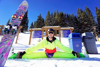 Josh Barilar of Breckenridge stretches at the top of the Colorado SuperChair during Breckenridge Ski Resort's opening day for the 2015-16 season.