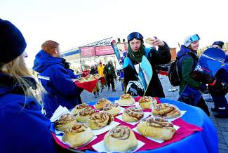 Breckenridge Ski Resort employees welcome guests with cinnamon rolls during the resort's opening day Friday.