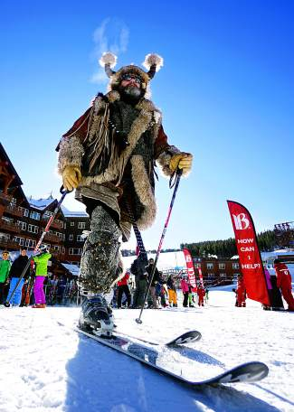 Ullr arrives at the base of Peak 8 for Breckenridge Ski Resort's opening day Friday.