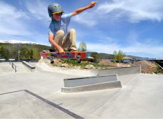 Blaze Ebbinghaus teaks an Indy off a concrete hip at the Breckenridge skate park earlier this summer. This Saturday, the town of Breck and Colorado Springs nonprofit Sk8-Strong host the first-annual Battle on the Blue, an open skateboarding competition for vert and street skaters with divisions for juniors, men, women and masters.