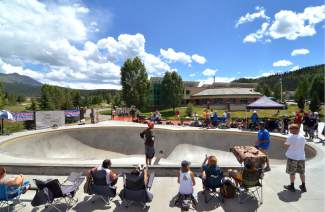 A crowd gathers around the large bowl at the Breck skate park for the vert contest at the first annual Battle on the Blue skateboard competition on July 23.