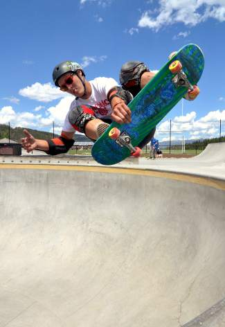 Otto Pfalnz, 24, of Denver grabs indy out of the big bowl during the Battle on the Blue skateboard contest at the Breck skate park on July 23.