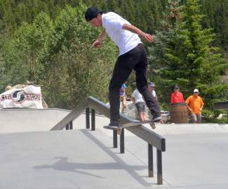 A competitor with a backside lipslide during the street contest at the Battle on the Blue skateboard event at the Breck skate park on July 23.