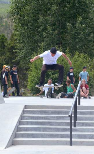 A competitor takes a frontside 180 over the seven stair during the Battle on the Blue street skateboard contest at the Breck skate park on July 23.