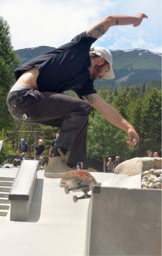 Breck's Grayson Clifford grinds the down ledge at the Breck skate park during the first annual Battle on the Blue skateboard contest on July 23.
