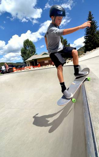 Jake Canter, 13, of Evergreen skates the medium bowl at the Breck skate park after the youth division of the Battle on the Blue skateboard competition on July 23. Canter took first in the vert competition.