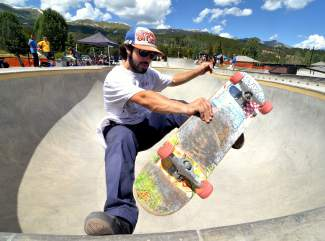 Stefan Wilson, 24, of Denver tweaks a fast plant out of the large bowl during the Battle on the Blue skateboard contest at the Breck skate park on July 23.