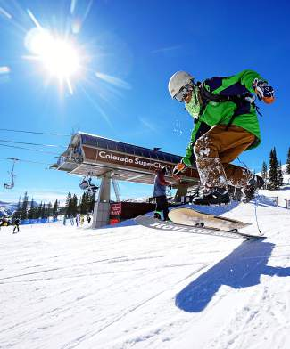 Clayton Conway takes a running start on his snowskate near the top of Peak 8 at Breckenridge on Feb. 17. The 33-year-old Conway, who was a snowboarder for most of his life, prefers the freedom of riding without bindings these days and has for about a decade.