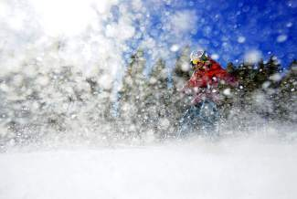 Angelica Clemmer emerges through spray on a snowskate at Breckenridge on Feb. 17. The resort was one of the first to allow snowskates (decks with skis and no bindings).