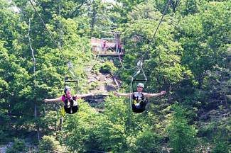 Breckenridge's expansion plan includes two mile long  ziplines like the ones pictured, in addition to canopy tours, ropes courses and other summer activities.