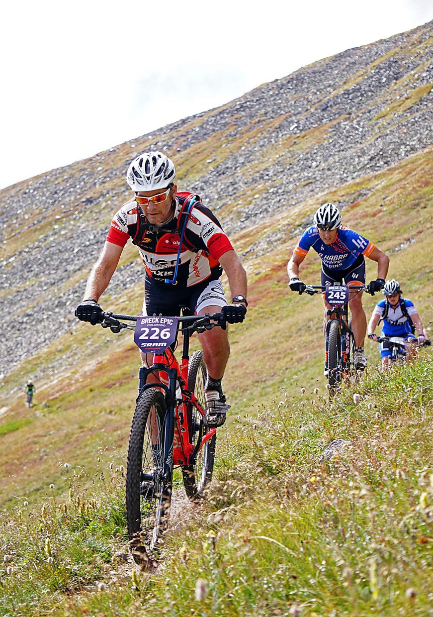 Sergio Correa, left, leads a group of riders along Wheeler Trail on Peak 9 during Stage 5 of the Breck Epic Thursday, Aug. 18, 2016.