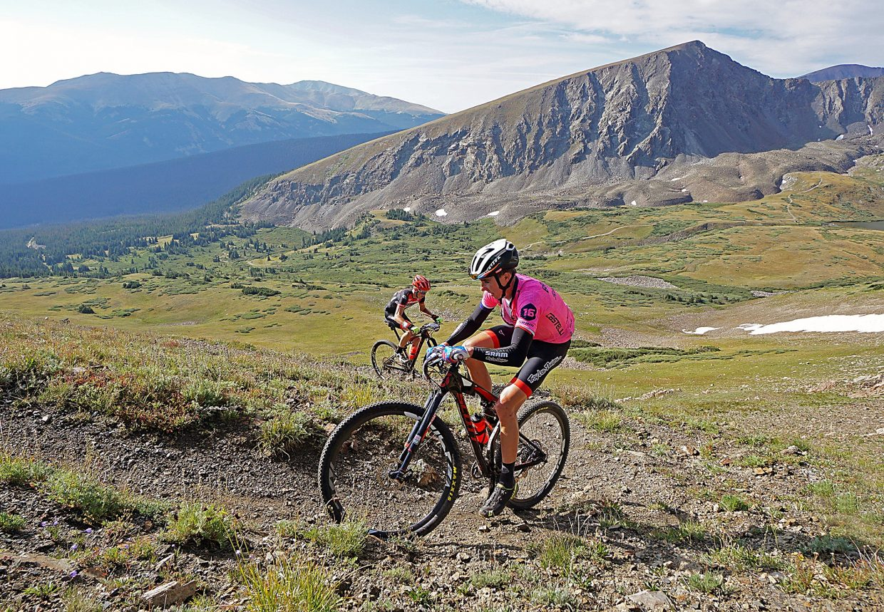 Breck Epic race leader Todd Wells is followed by Russell Finsterwald as they make their way up Wheeler Pass during Stage 5 Thursday, Aug. 18, 2016.