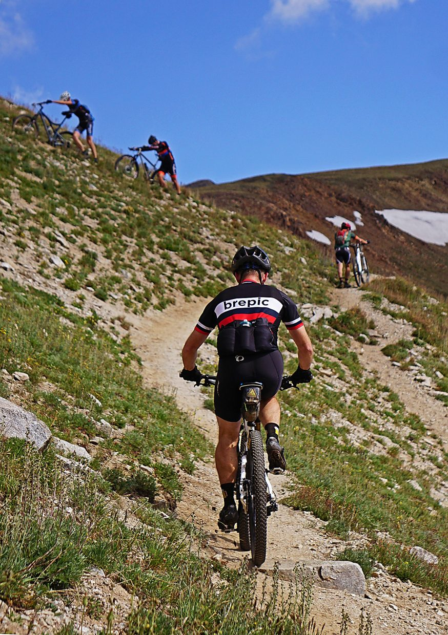 As racers hit the steep final push up to Wheeler Pass, many opt to hike while few remain on their bikes during Stage 5 of the Breck Epic Thursday, Aug. 18, 2016.
