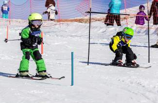 Young ski racers tuck past gates during a Bubble Gum race at Frisco Adventure Park earlier this winter. The free series finale comes to the park on March 28 and is open to skiers and snowboarders of all ages.